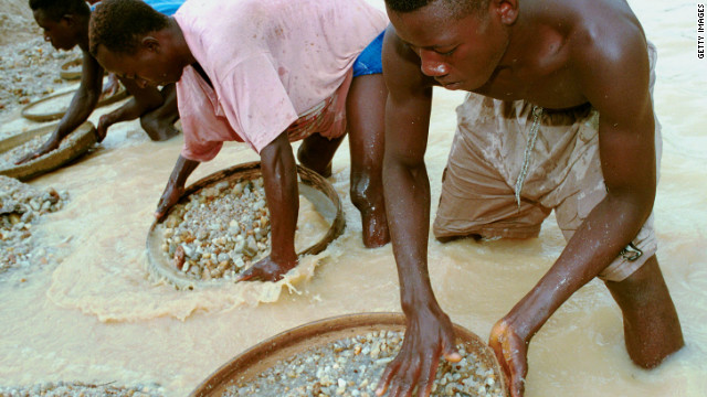Workers pan for diamonds in a government-controlled diamond mine near Kenema, Sierra Leone, on June 15, 2001.
