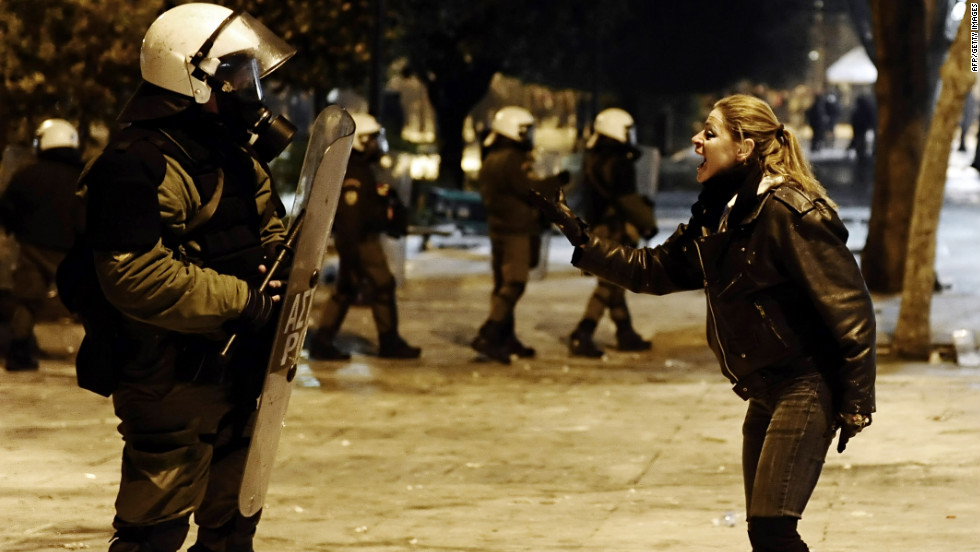 A protester shouts at a riot policeman during clashes.