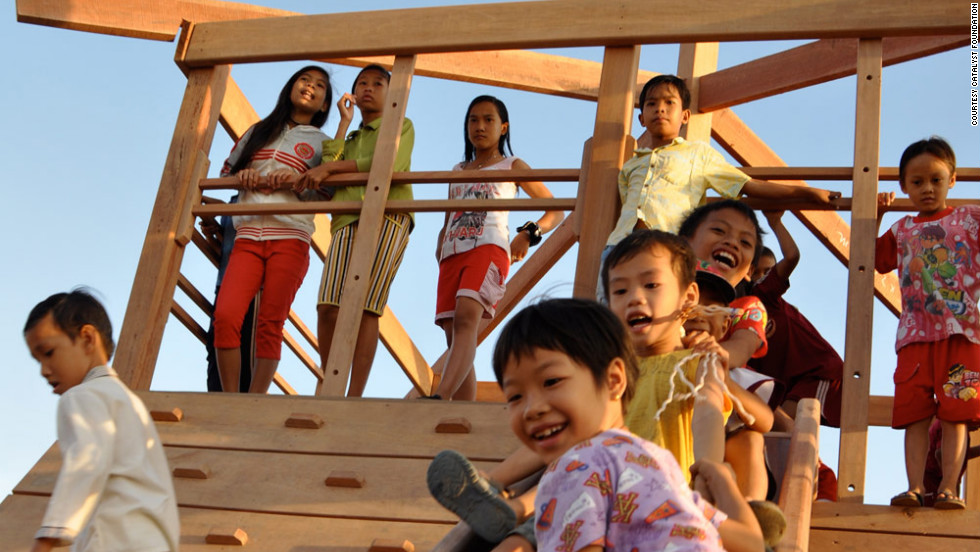 The children at the school learn how to avoid traffickers. They also get a chance to have fun on their first playground.