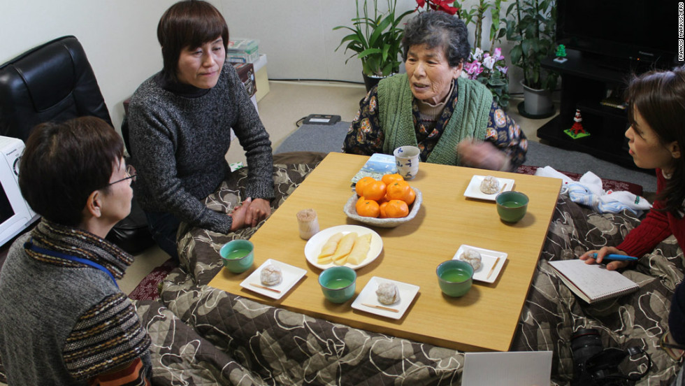 78-year-old grandmother Teru Yamada (second from right) is one of thousands of people forced to live in temporary housing since last year's disaster.