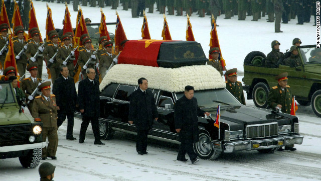 The funeral procession for North Korean leader Kim Jong Il proceeds through Pyongyang on December 28.