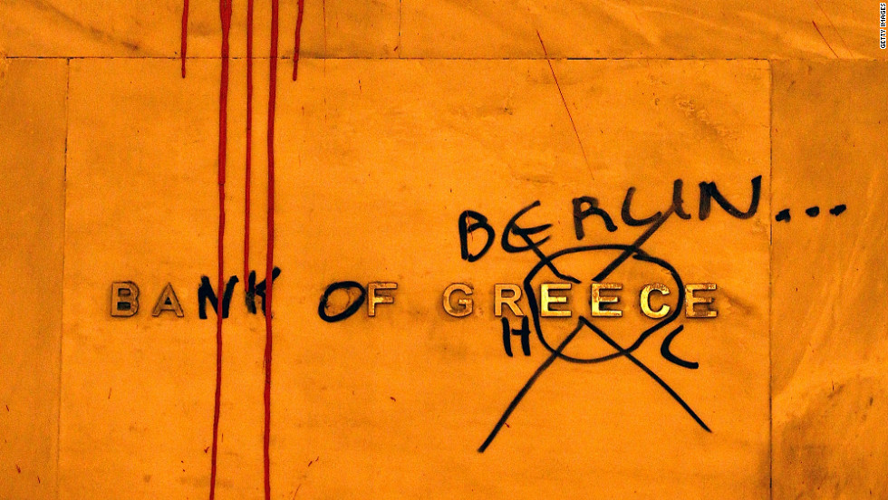A detailed view of the Bank of Greece sign is seen on its bulding during the demonstration against the new austerity measures in Syntagma Square on February 12