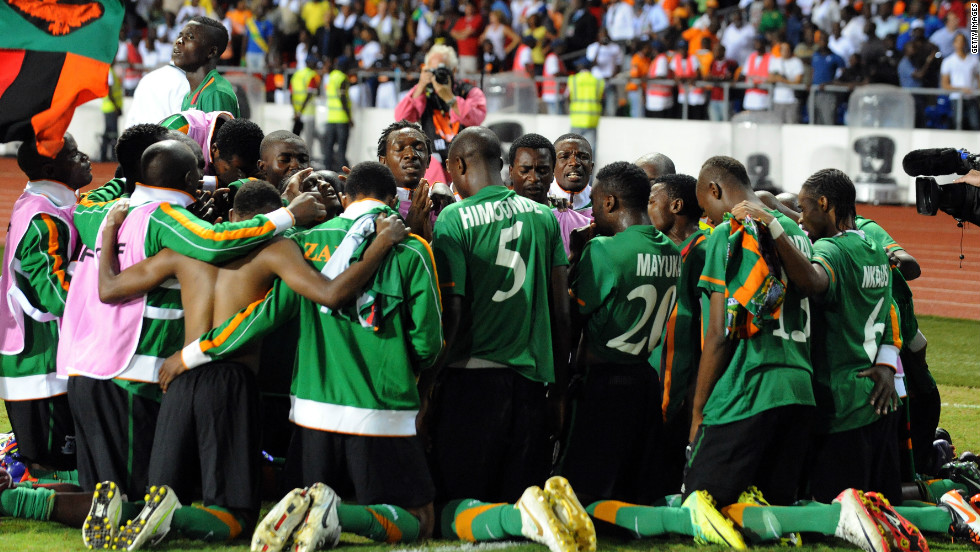 The Zambia team gather together in prayer moments after Stoppila Sunzu's penalty earned the Copper Bullets' first African title.
