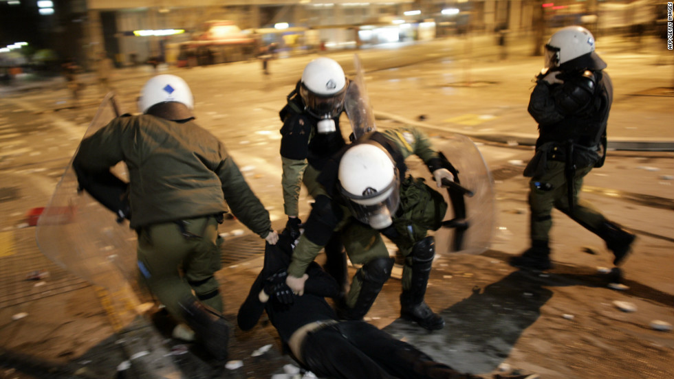 Police arrest a protestor in the streets during a demonstration against austerity measures on February 12, 2012 in Athens.