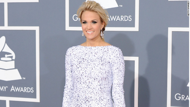 "Carrie Underwood's fourth album, ""Blown Away"" is her third straight number one album."