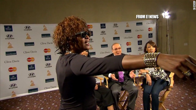 Whitney Houston shares a moment with her daughter Bobbi Kristina Brown and mentor Clive Davis.