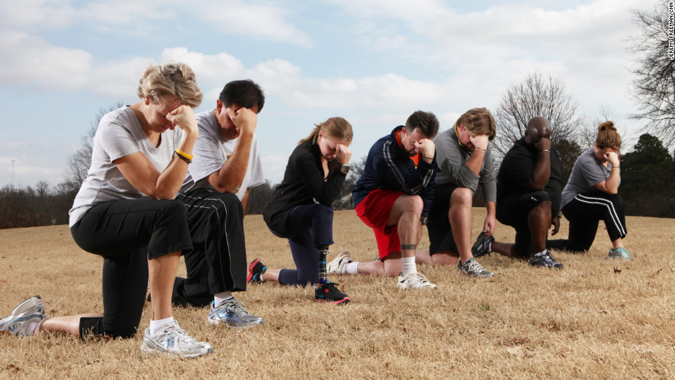 The Fit Nation team stops to strike a 'Tebow' in between workouts
