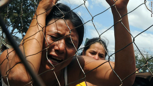A woman cries outside the National Prison compound in Comayagua, on February 15, 2012, following a fire overnight which tore through the prison in central Honduras. At least 272 inmates were killed, officials said, warning the toll could rise with many inmates left trapped in their cells by the fierce inferno.