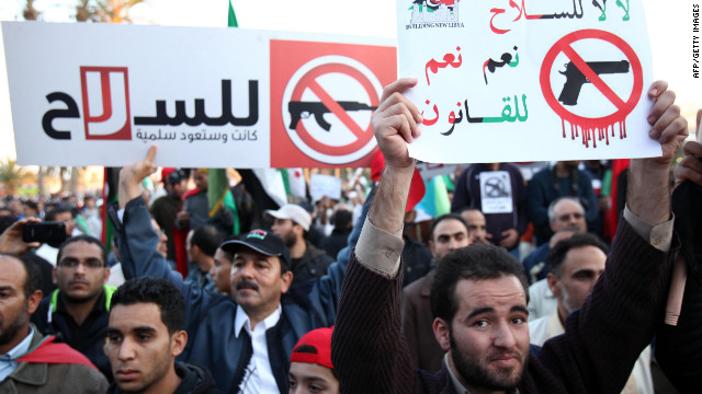 "Libyan demonstrators hold banners that read, ""No for arms, yes for law"" in Tripoli's landmark Martyrs Square in December."