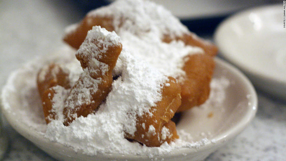 "It's time to party, with Mardi Gras celebrations under way in New Orleans. So go ahead and start working on a strong foundation of greasy deliciousness such as these beignets at Cafe du Monde. Check out our top reader picks in ""<a href=""http://www.cnn.com/2012/02/17/travel/destination-usa-new-orleans-food/index.html"">Best bites in the Big Easy</a>."""