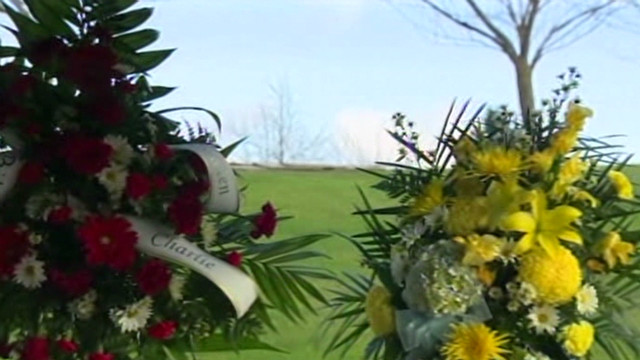 Protest over Powell grave site near sons