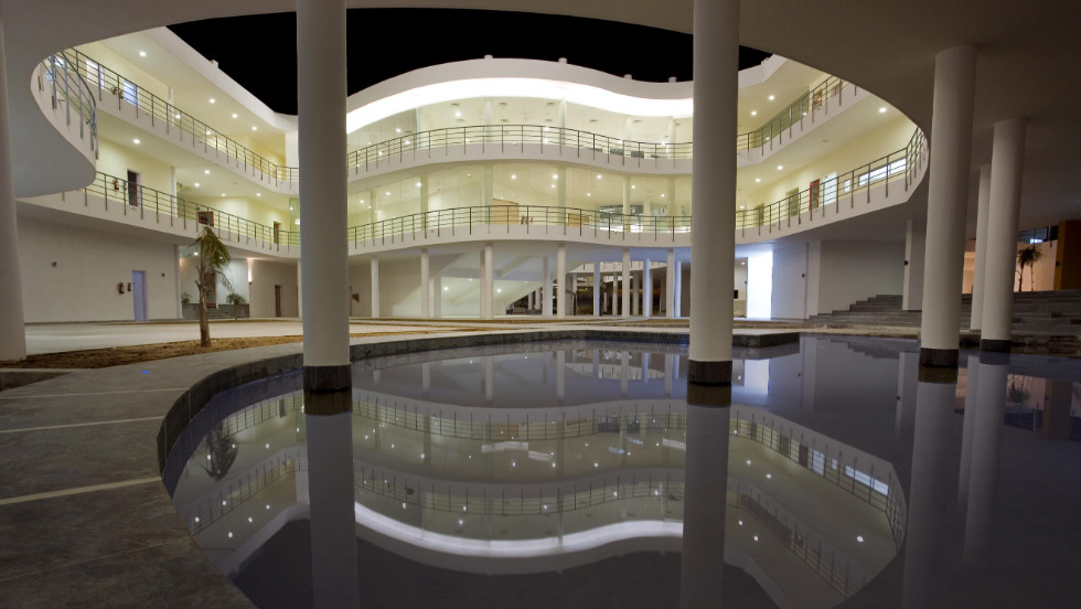 "The entire building is raised above the ground and a pool of water -- integrated into a recreation and exhibition space -- keeps temperatures low through evaporative cooling. As architect Manit Rastogi says, ""When water evaporates in heat, it immediately brings down the temperature of the space around it."""