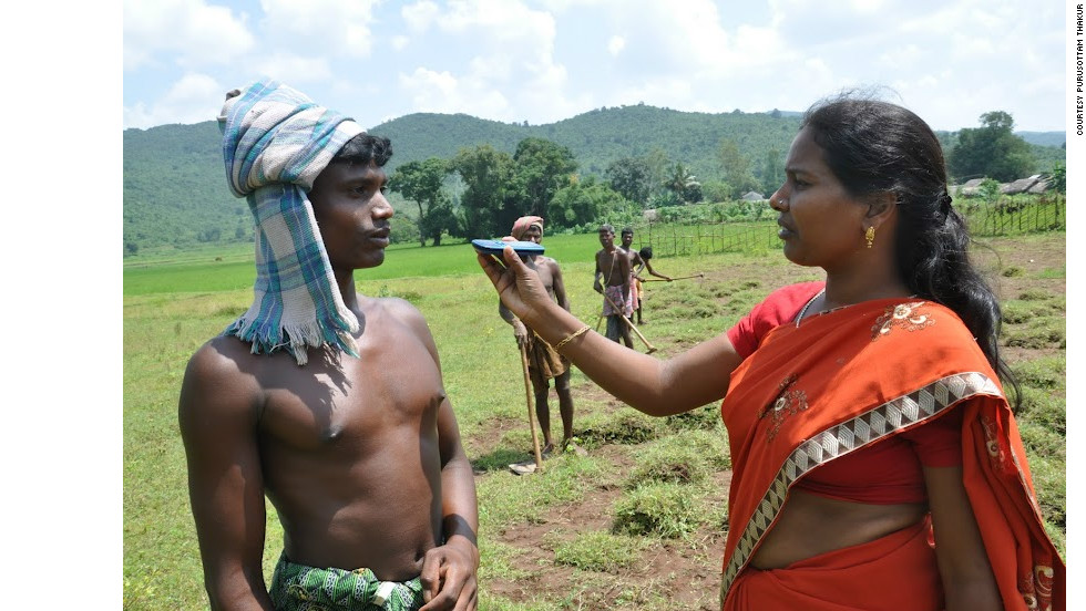 A citizen journalist conducts an interview using her mobile phone in Chhattisgarh state, India.