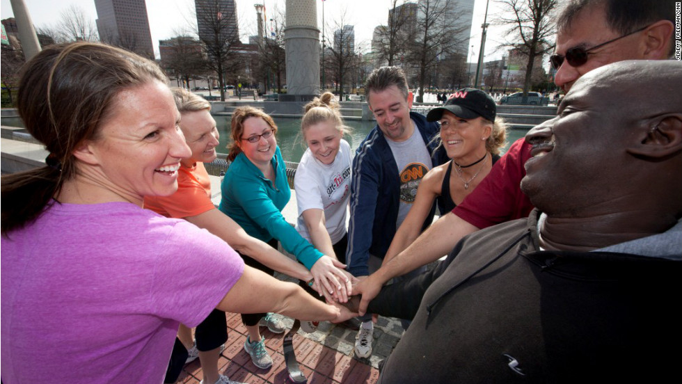 The team and coaches April Burkey and Laura Cozik get a 'teamwork' before a run work out in Atlanta's Centennial Olympic Park