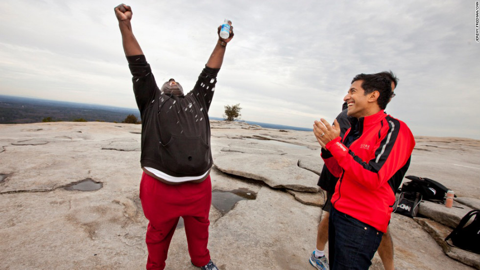 Participant Glenn Keller does his best 'Rocky Balboa' after summiting Stone Mountain with Dr. Sanjay Gupta and his teammates