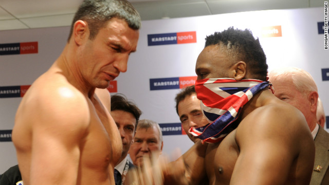 Derek Chisora slaps WBC heavyweight champion Vitali Klitschko at the weigh-in ahead of their fight earlier this month