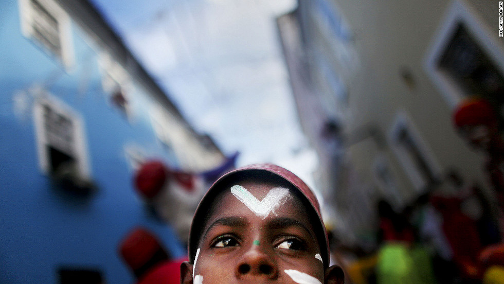 A boy awaits the start of a parade on the second day of Carnival celebrations on Friday in Salvador, Brazil.