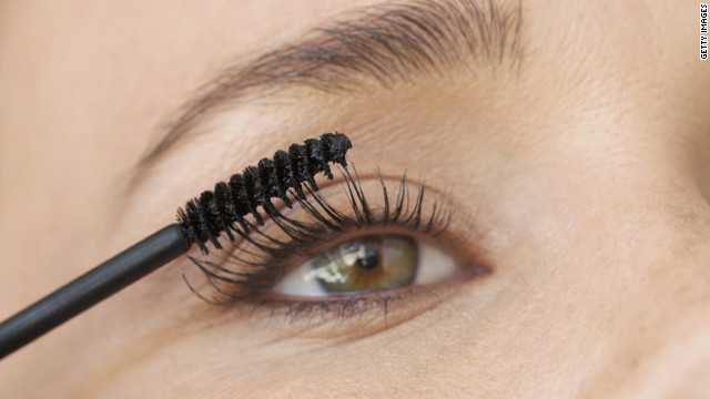 Put on mascara by rolling your hand up and away from your eye to help separate lashes.