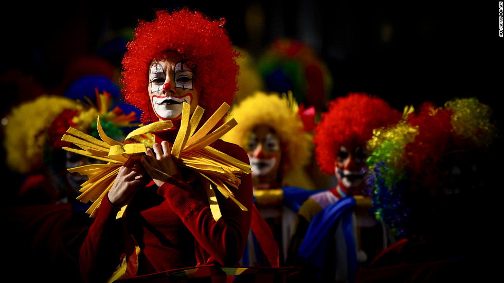 Clowns take part in the annual carnival parade in Loule, Portugal, on Saturday.