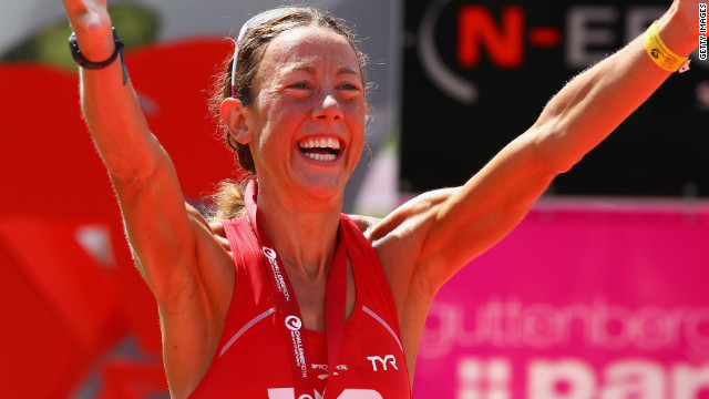 Chrissie Wellington celebrates winning the Challenge Roth Triathlon with a new long distance world record in 2011.