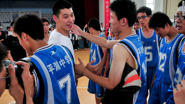 Jeremy Lin shakes hands after a friendly match last year at a school in Pinghu, Zhejiang province, his family's ancestral home.