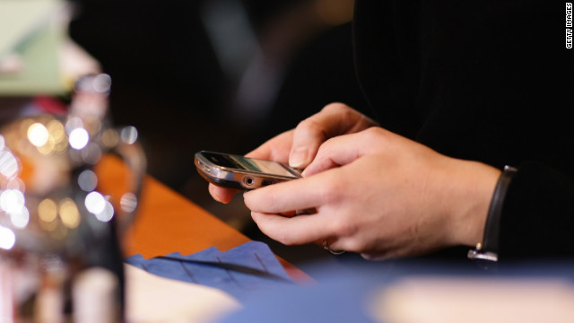 "Send a quick ""I'm here!"" text, then put your phone away and strike up a conversation with the bartender."