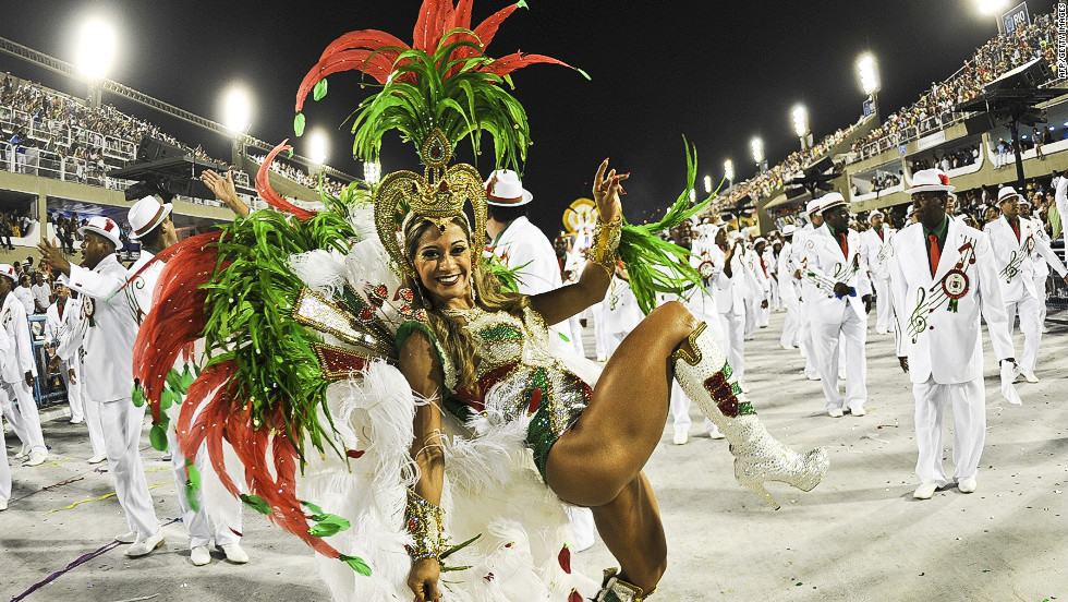 A reveler from the  Grande Rio samba school performs  at the Sambadrome in Rio de Janeiro, Brazil, early Tuesday, February 21. Countries around the world celebrate before the beginning of Lent with balls, parties, and parades with floats and costumed dancers.