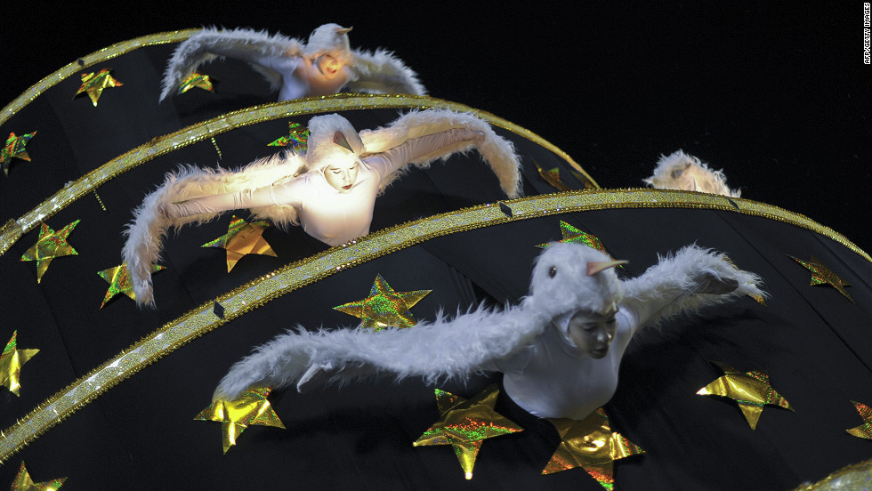 Members of the Unidos da Tijuca samba school dressed as birds perform on a float during a carnival parade at the Sambadrome in Rio de Janeiro on Tuesday.