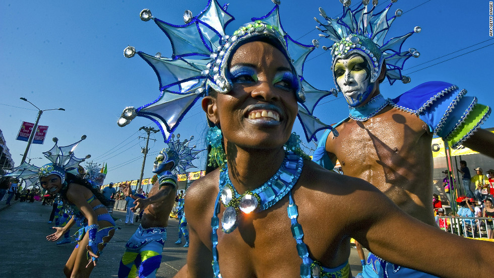 Revelers parade through the streets in Barranquilla, Colombia, on Monday.