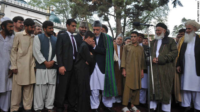 Afghanistan's President Hamid Karzai pardons a would-be child suicide bomber on August 30, 2011.