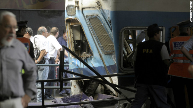 A policeman walks in front of a train that crashed at Once train station in Buenos Aires on February 22, 2012.