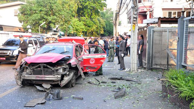 A shattered car at a Bangkok bombing crime scene on Wednesday, February 22, 2012.