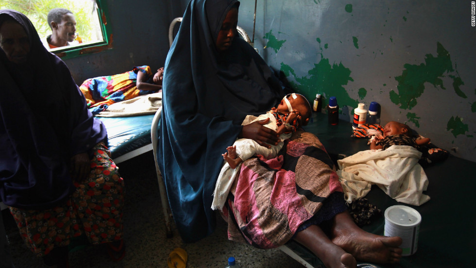 Amid the violence, the Somali people have endured bouts of natural disasters, including famine, drought and floods. In this picture, Farhiyo Hassan sits with her sick and malnourished two month-old twins at the Banadir hospital in Mogadishu, in August 2011. The U.S. government said 30,000 children had died in Somalia due to famine in the previous three months alone.