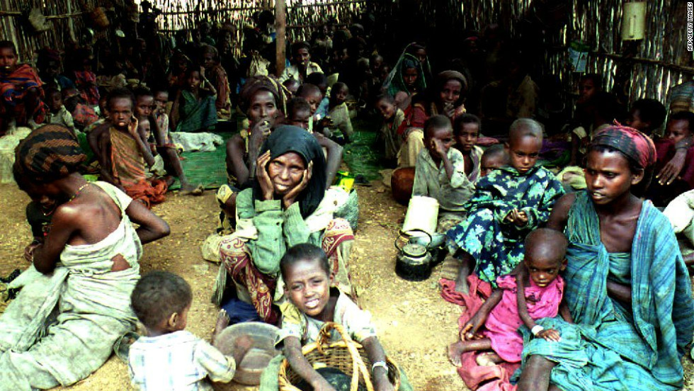 For over 20 years Somalians have faced the horror of famine and war. In this image from 1992, women and children sit inside a feeding centre run by the International Committee for the Red Cross (ICRC) in Baidoha, Somalia, during a period of extreme famine and drought that claimed  300,000 lives, according to the U.N. Security Council.