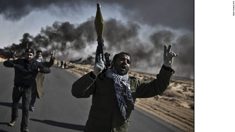 Ochlik was born in eastern France, and studied photography in Paris, before setting up his own picture agency, IP3 PRESS.Photo: Libyan opposition fighters go to the front line, armed with RPGs and flashing victory signs, outside Ras Lanouf .