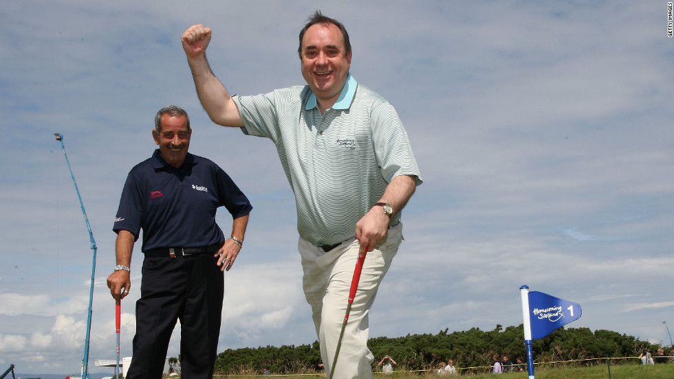 Scoltand's political leader  Alex Salmond is a keen golf fan but his government faces a difficult decision over the offshore wind farm as Trump threatens to pull his investment.