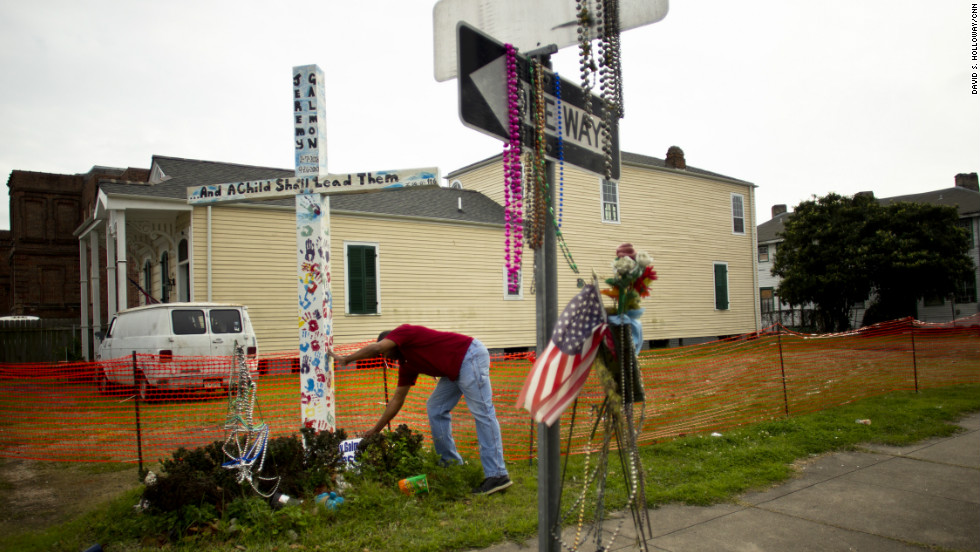 Reminders of death can be found across the area as people honor their loved ones. Fredric Sweetwyne celebrates the life of Jeremy Galmon with a commemorative cross in the Central City neighborhood.
