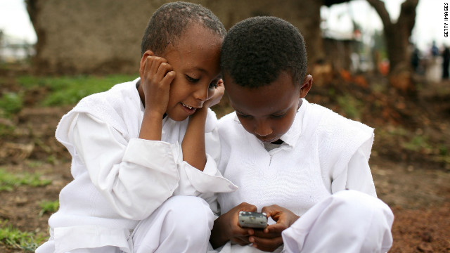 Two boys play with a cellular phone in Debre Zeit, Ethiopia.