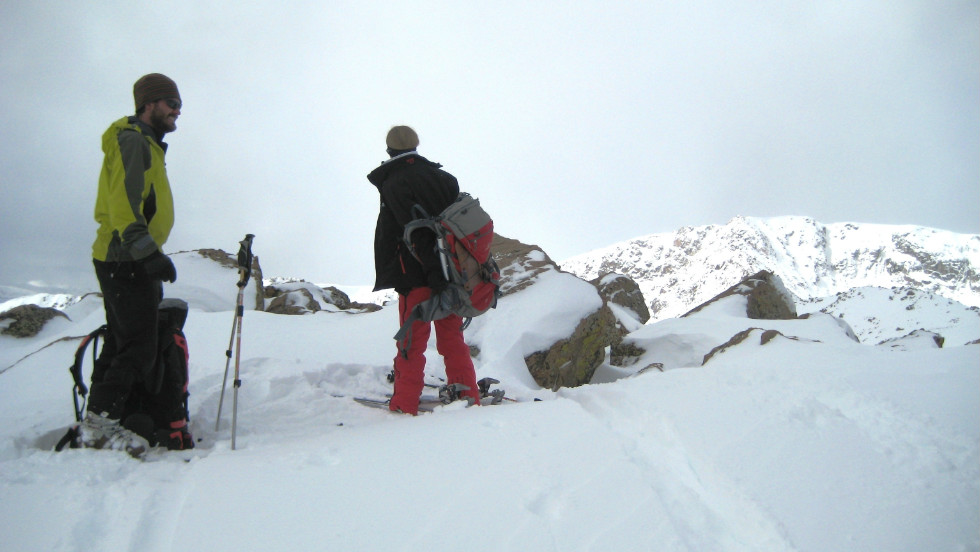 Backcountry ski guide Will Elliott, left, rests at around 12,500 feet on the east ridge of Galena Mountain.