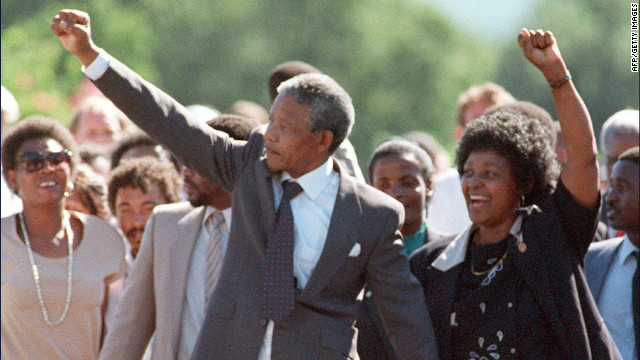 PAARL, SOUTH AFRICA - FEBRUARY 11: ANC leader Nelson Mandela and wife Winnie raise fists upon his release from Victor Verster prison, 11 February 1990 in Paarl. (Photo credit should read ALEXANDER JOE/AFP/Getty Images)