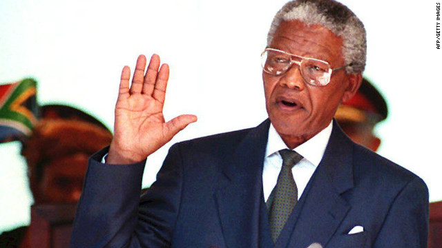 PRETORIA, SOUTH AFRICA: South African President Nelson Mandela takes the oath 10 May 1994 during his inauguration at the Union Building in Pretoria, South Africa. Mandela was elected as the nation's first black president during the first session of the country's post-apartheid parliament 09 May in Cape Town. (Photo credit should read WALTER DHLADHLA/AFP/Getty Images)
