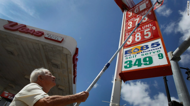 MIAMI, FL - FEBRUARY 21: Louis Ra Mil changes the price of gas on the sign outside of Ugas in a county where some grades of gasoline have already surpassed the $4 mark on February 21, 2012, in Miami, Florida.