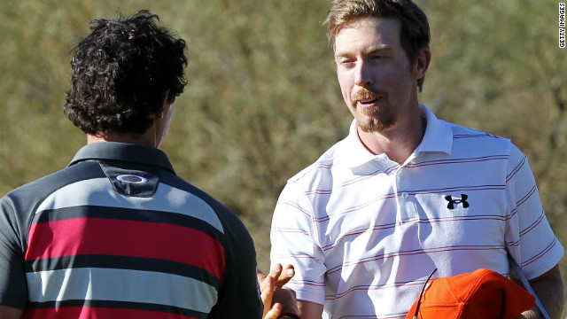 Hunter Mahan shakes hands with Rory McIlroy after beating him 2&1 in the final in Arizona.