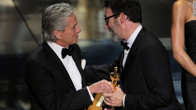 "Michel Hazanavicius accepts the Best Director award for ""The Artist"" from presenter Michael Douglas on Sunday night."
