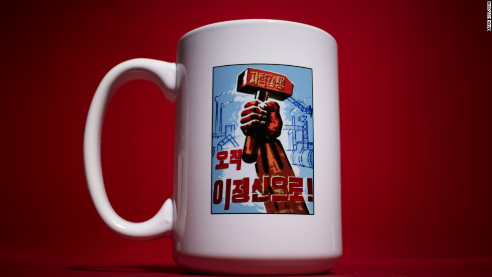 "Now available to foreigners on a coffee mug, Song Byeok painted this same design on three factory billboards inside North Korea. It says ""Self-Reliance: This Is Our Only Belief."" The mug is made in China."