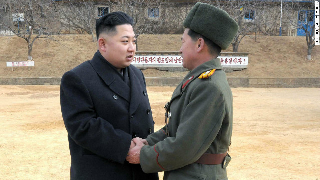 This undated photo shows North Korean leader Kim Jong Un, left, with a senior military officer at an undisclosed location.