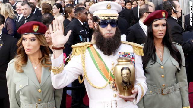 "Sacha Baron Cohen arrives on the Oscars red carpet as his character from his new film, ""The Dictator."""