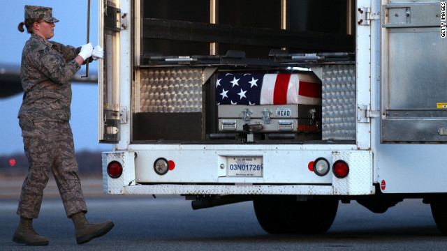 Troops at Dover Air Force Base on Monday transfer the caskets of two U.S. officers who were killed in Afghanistan.