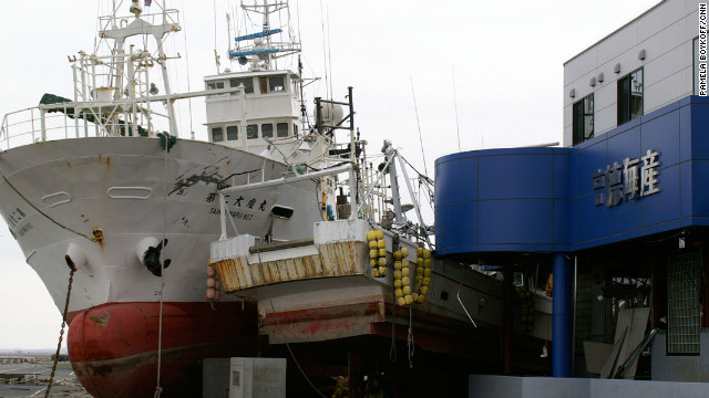 The tsunami wave swept this ship into Tokuyoshi Takahashi's fish processing factory in northeastern Japan.