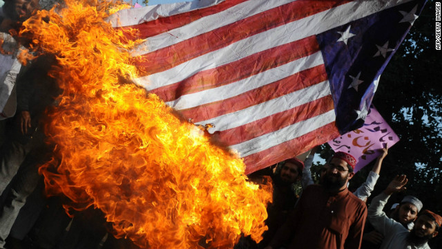 Activists of Majlis Ulma Nzamia Pakistan burn a US national flag during a protest in Lahore on February 27, 2012.